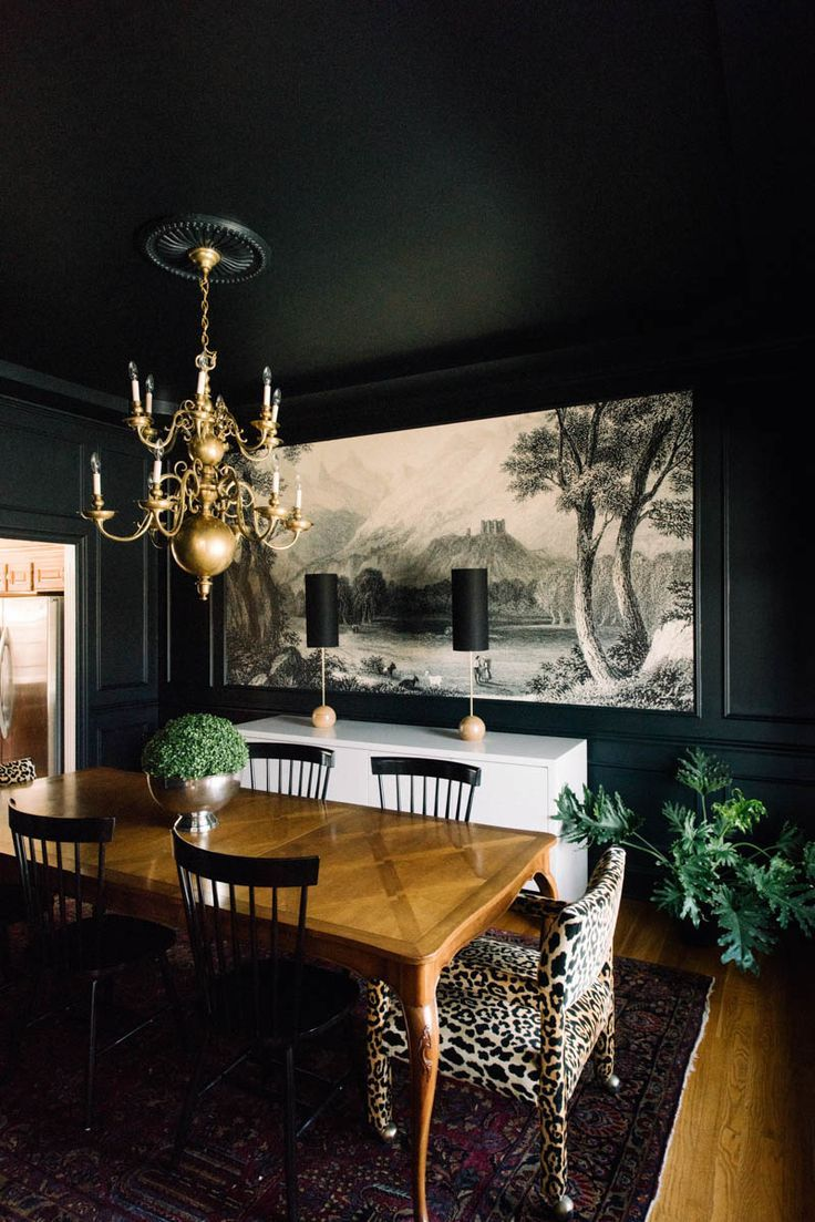 Black Wall and black ceiling Interior oversized art - the detail of the cheetah chair is nice