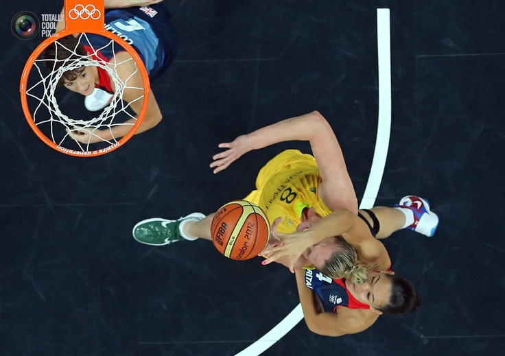 Great Britain's Stewart grabs Australia's Batkovic during their women's Group B basketball match at the London 2012 Olympic Games in the Basketball arena.