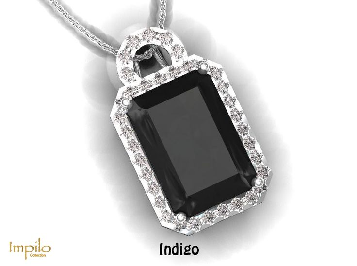 """""""Indigo"""" - Stunning onyx surrounded by round brilliant cut diamonds in the halo and on the bail."""