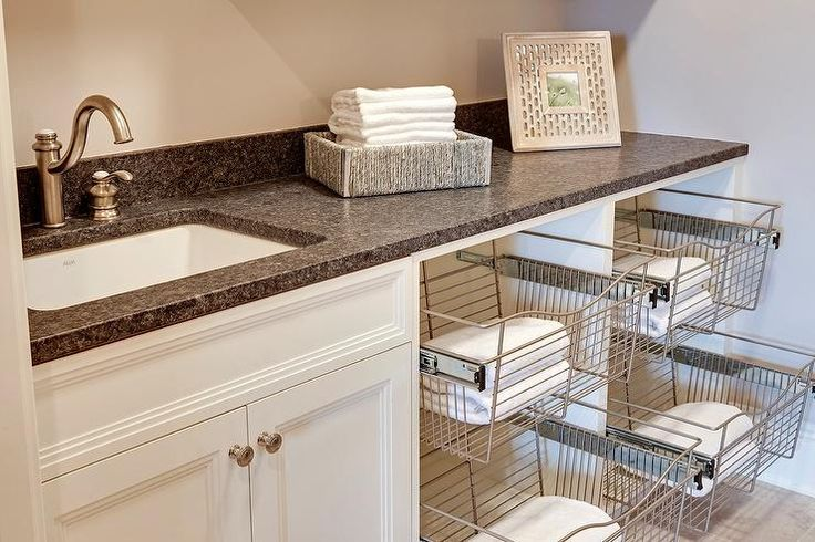 Fantastic Laundry Room Features White Cabinets Topped With