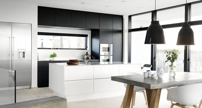 Modern black and white sleek kitchen * Concrete table w wooden legs * White Hay About a Chair * Black lamps
