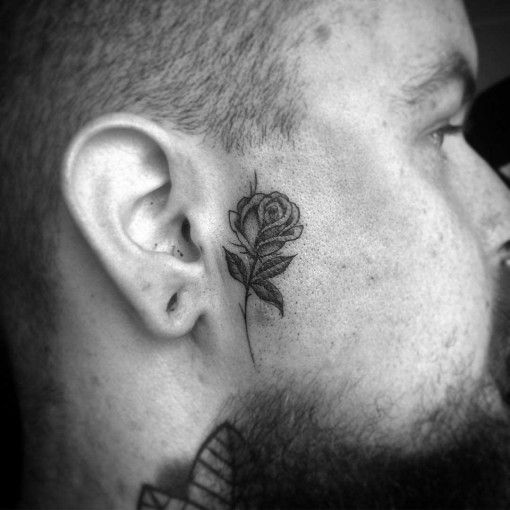 rose tattoo on face Chicano