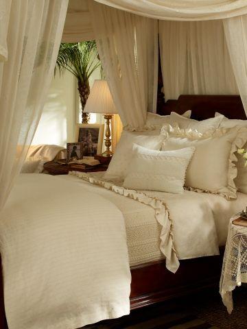 Romantic linen draped canopy bed