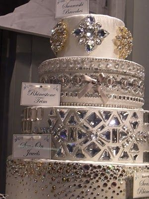 OMG!   NOw that's a wedding cake!!! :) Hope it's edible. I would put the  jewels on a clear backing to make it easy to remove before cutting ! Oh,,yes I'd make this work ,lol for my girls ! (that is something...)