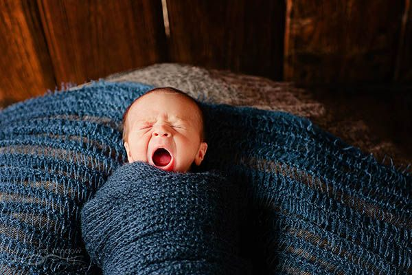 newborn photography on country property baby yawn.