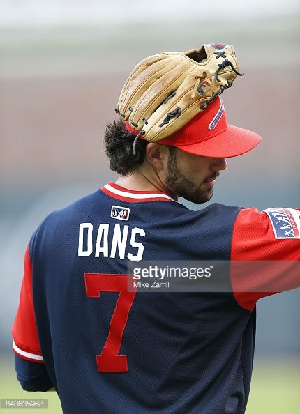 Shortstop Dansby Swanson of the Atlanta Braves warms up while wearing his 'Dans' nickname jersey before the MLB Players Weekend game against the Colorado Rockies at SunTrust Park on August 25, 2017...