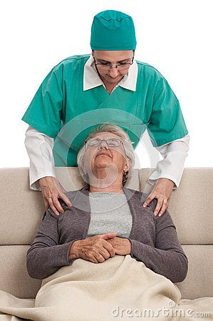Young nurse women massaging shoulders of a female senior at home on sofa. Isolated on white.
