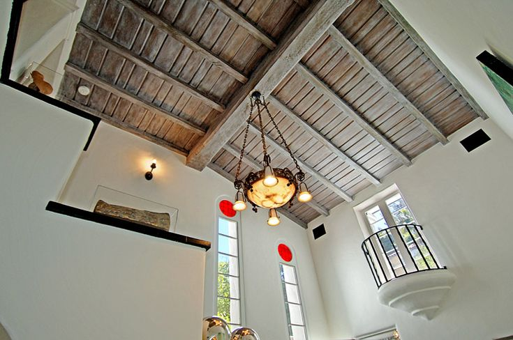 High ceilings with wood in lays makes an already big house bigger - Charlie Sheen