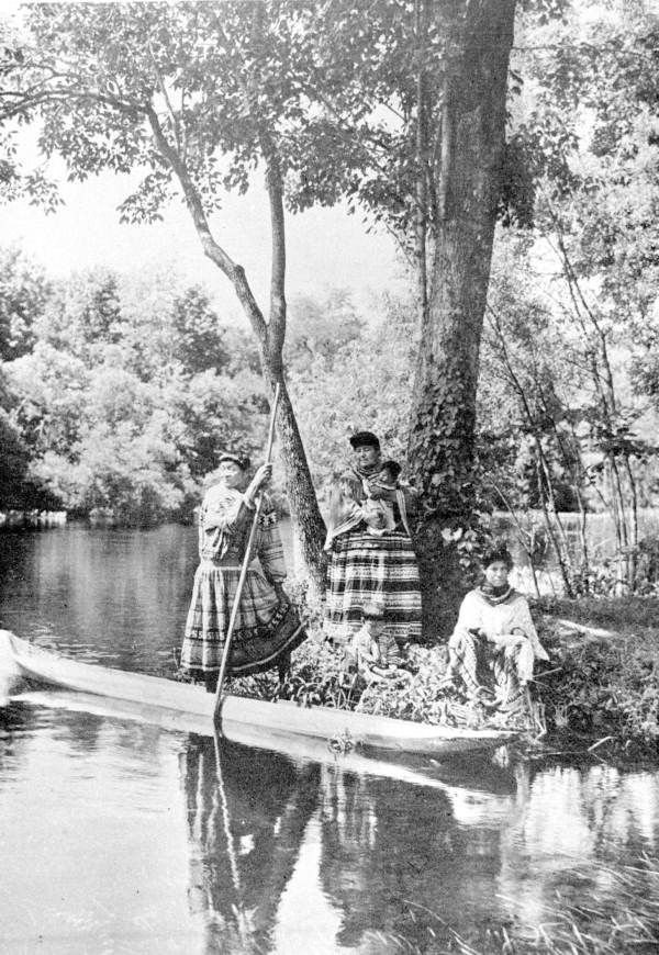 Seminoles with their canoe