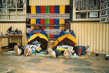"The Ndebele people live in South Africa and Zimbabwe. Mother-in-law of the Ndebele bride makes her a ""jocolo"". The Jocolo is a five-paneled, beaded goatskin apron. During ceremonies this apron is worn by all married women."