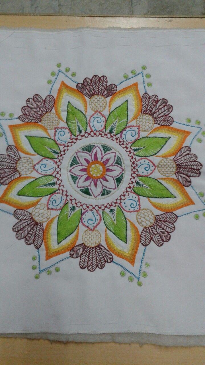 Manda,  bordado tradicional