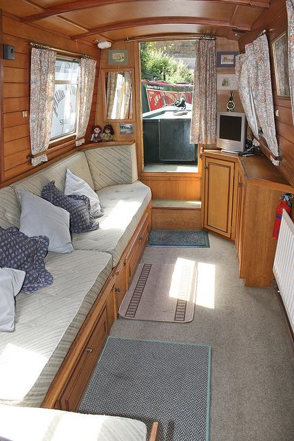 Love the corner sofa on a canal boat really opens the space up and allows for more lounging space