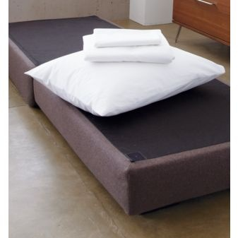 The ottoman, flipped into a bed.