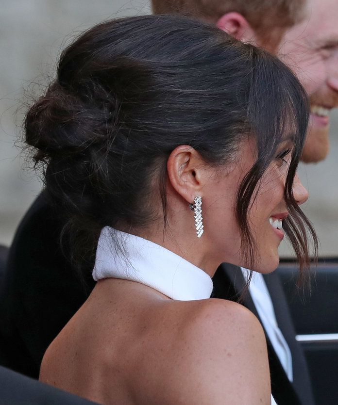 Leaving for the Royal Wedding Reception | Meghan Markle's updos are quickly becoming the most talked-about hairstyles of the moment because they're so wearable and effortless-looking. See 10 gorgeous Meghan Markle updo hairstyles here.