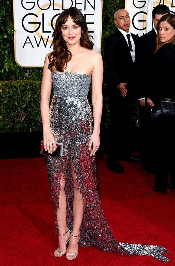 Dakota Johnson in a silver Chanel gown at the 72nd Annual Golden Globes
