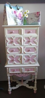 pink and white painted dresser // I don't know why I like this, too fluffy.
