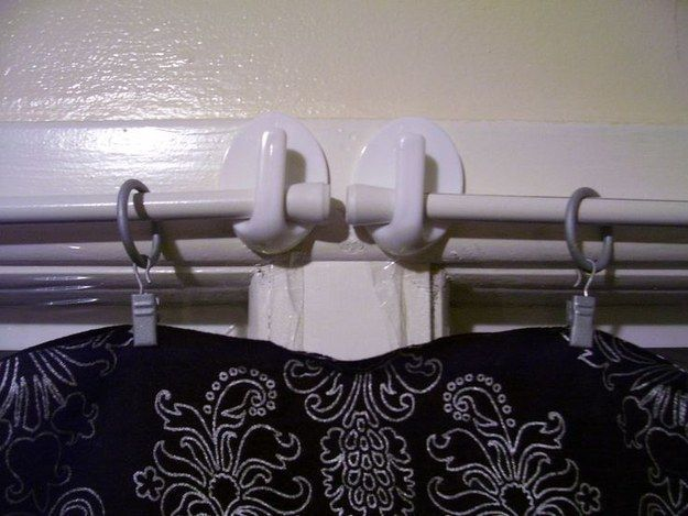 Command hooks are a super easy way to hang curtains. | 37 RV Hacks That Will Make You A Happy Camper