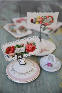 Placecard holders made from sugar bowl lids and vintage Valantine cards.