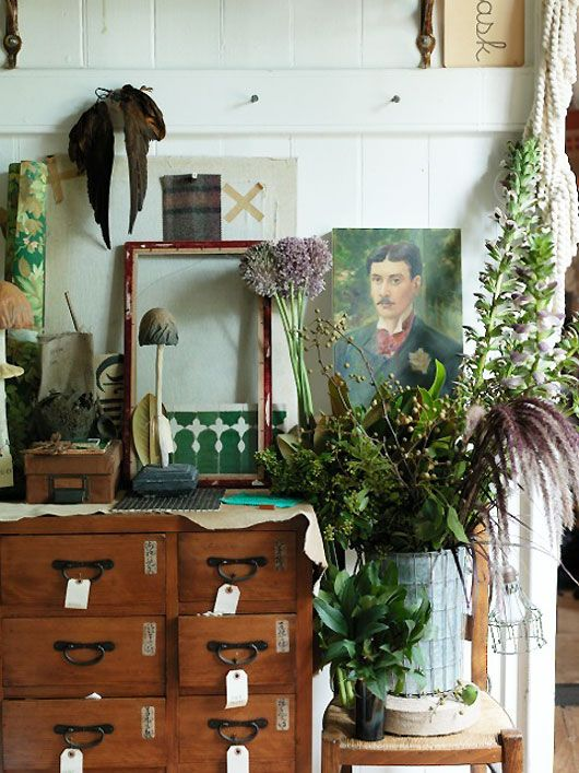 This is a space that screams creativity. The dark greens mixed with vintage feel just seems good. sibella-court