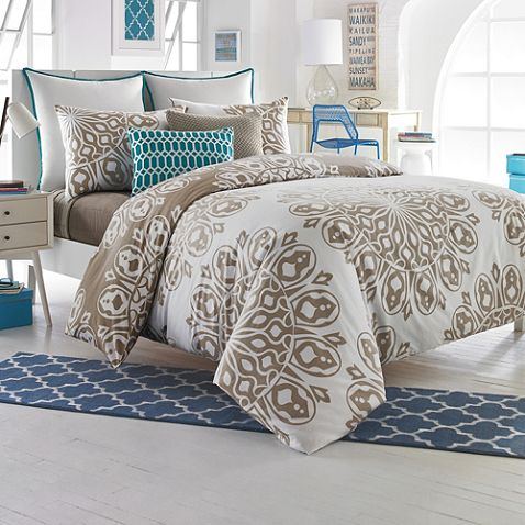 bring design into your bedroom with the studio cyndi reversible duvet cover set dressed in a stylish medallion design that reverses to solid