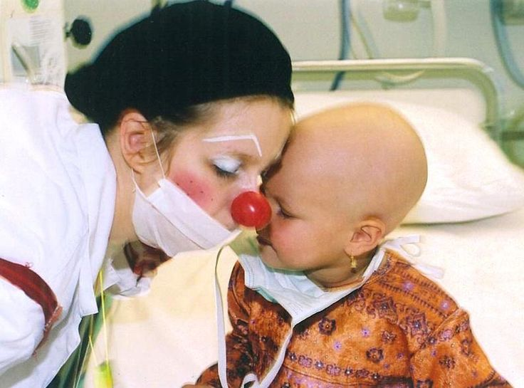 Clown doctor, New Zealand, bringing her gift of humor to what appears to be a young cancer patient