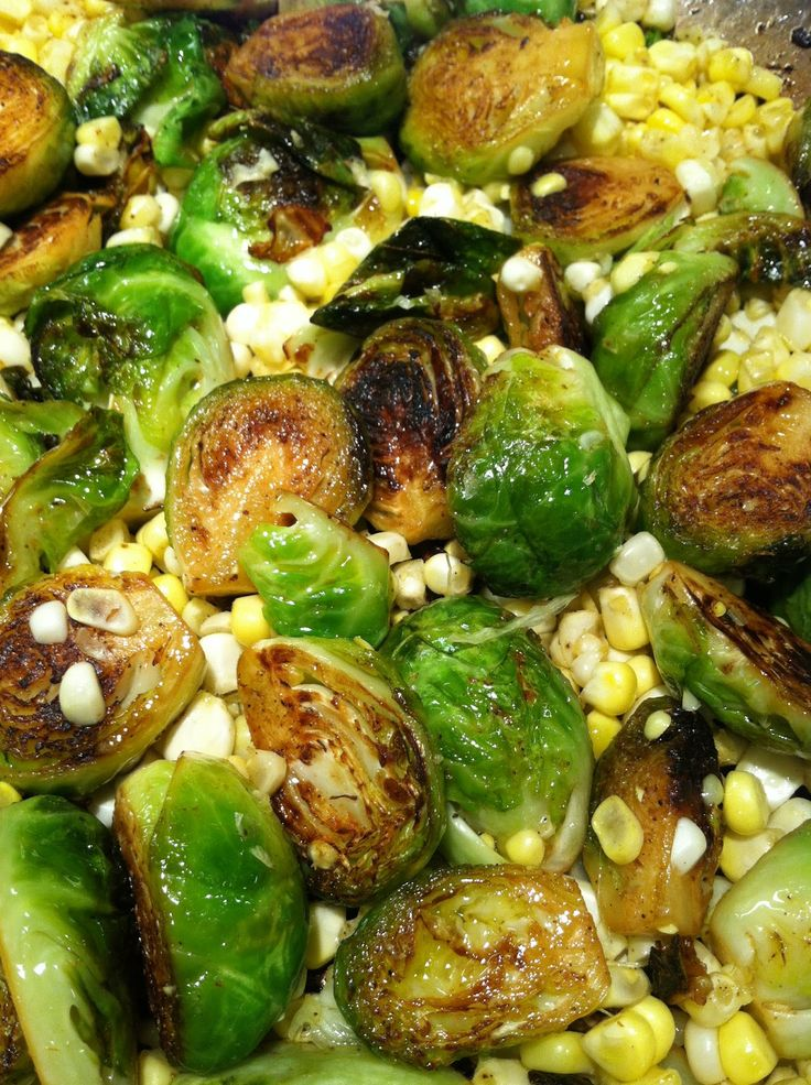 Great summer side dish: pan seared brussel sprouts & corn with lemon, cayenne pepper, garlic, onion, salt & pepper. Easy, quick, healthy.