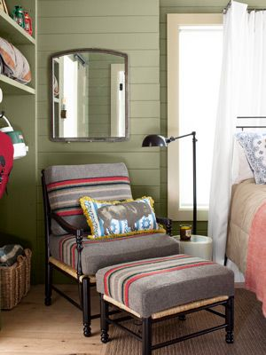 Country Living - 2012 House of the Year: Guest Bedroom Cottage > Thomas upholstered this Ballard chair with Pendleton throws and added rustic charm by leaving the floorboards unfinished.