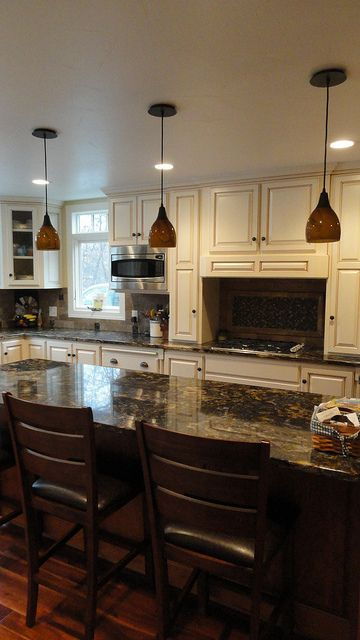 Color option to paint oak cabinets in kitchen.  Cream glaze with dark counters