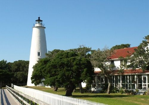 Ocracoke Lighthouse, The first Ocracoke Lighthouse was built in 1803 on Shell Castle Island inside the Ocracoke Inlet not far from Blackbeard's hideout. Destroyed by lightning in 1818 it was replaced by the current light in 1823 on the banks of the inlet near Ocracoke Village. Height of tower: 65 feet, 75 feet to focal plane, Year Completed: 1823 (Oldest operating lighthouse on NC coast), Signal Distance: 14 Nautical Miles, Signal Pattern: Fixed white light.