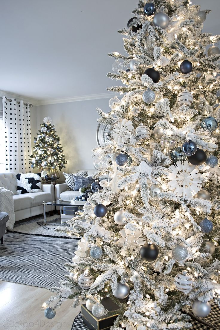 Denim Blue And White Christmas Decor Flocked Tree With White Black And Blue Ornaments B Blue Christmas Tree Blue Christmas Decor Beautiful Christmas Trees