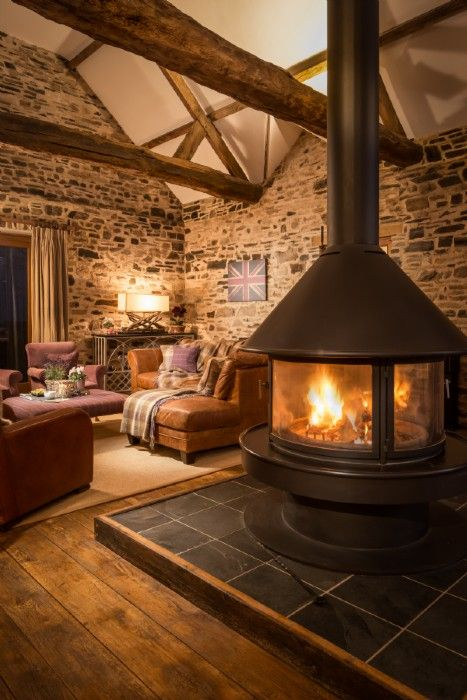 Cosy up by the crackling fire in the open-plan living area of Caspian Ranch