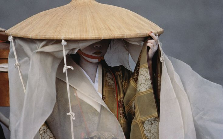A Geiko dressed in a noblewoman's travelling costume participates in the Jidai Matsuri (Festival of the Ages) procession, Kyoto, Japan (1993).
