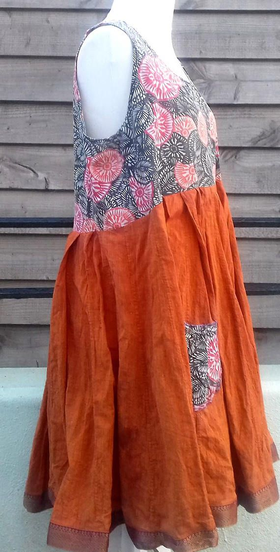A fabulous sleeveless cotton dress with very full skirt that is made of cotton but looks like silk. Block print patterned top and floaty burnt orange skirt with silk trim and cute pockets. Easy to wear, unique and one of a kind! Measurements: Bust 46 inches no stretch Waist (at join above
