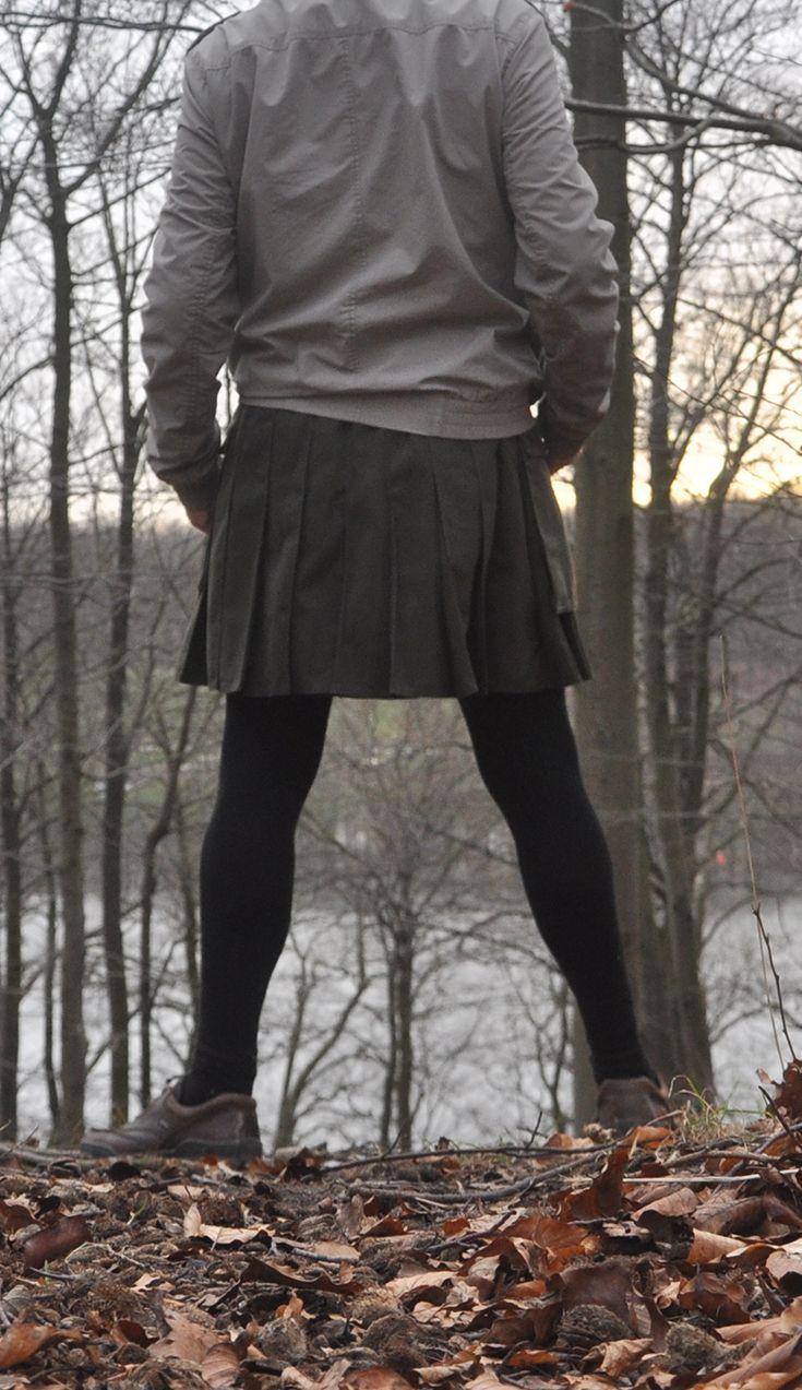 Short olive Utilikilt worn with black tights,