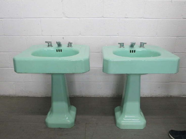 Photo Of Vintage bathroom sink faucets with porcelain handles