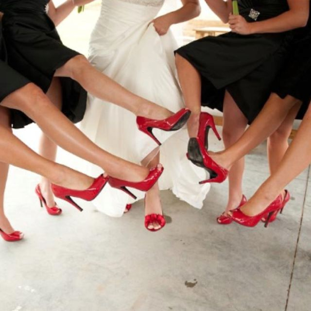 Love the red shoes with the black dresses.