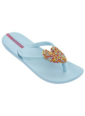 Baby blue flip flops with cushioned foot bed. Flip flop has a heart detail that is embellished with colorful sprinkles by Ipanema Flip Flops, $20.00
