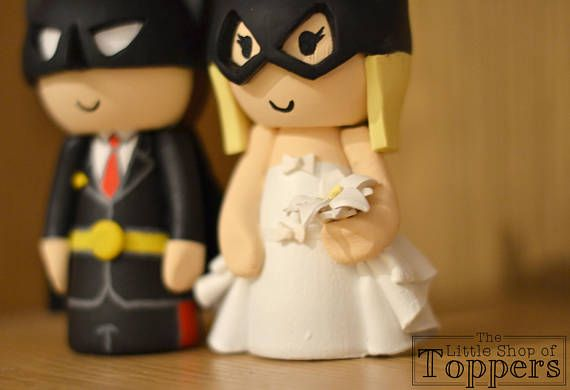 Batman and Batgirl Wedding cake toppers custom made and