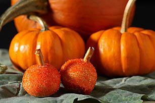 Oreo pumpkin balls.  Use pringles honey butter stix instead of pretzels and work fast. #Halloween