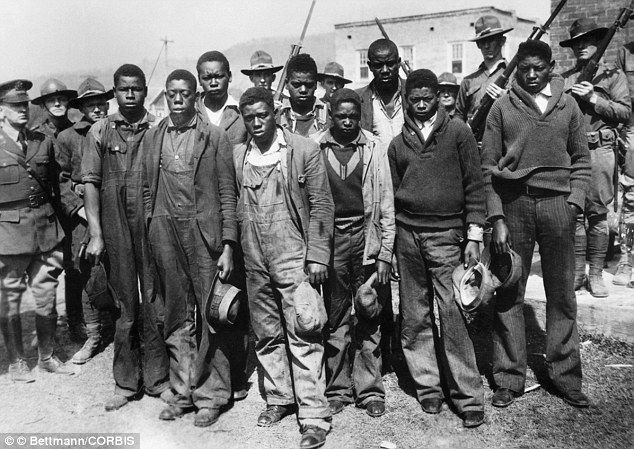 Accused: The false allegations to the 'Scottsboro Boys' had raped two white women in Alabama in the 1930s led to a race panic. The governor called the National Guards to protect the suspects from lynch mobs