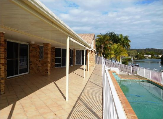 Wow, pool and waterfront views for you and your family available for rent in lush Elanora on the Gold Coast.