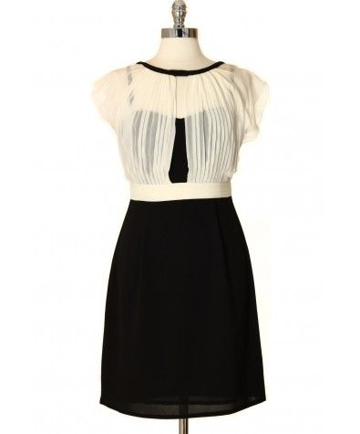 "Graceful black and white dress with a charming pleated overlay pattern; Delicate finished neckline. Wear to the office, a night out or a cocktail. Features a hidden 12"" zipper in the back."