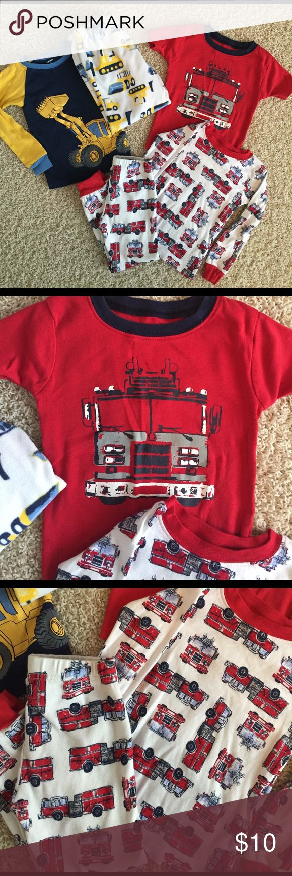 Boys pajama sets Two sets of boys pajamas. Both size 3T. The red T-shirt in the fire trucks that has never been worn. Carter's Pajamas Pajama Sets