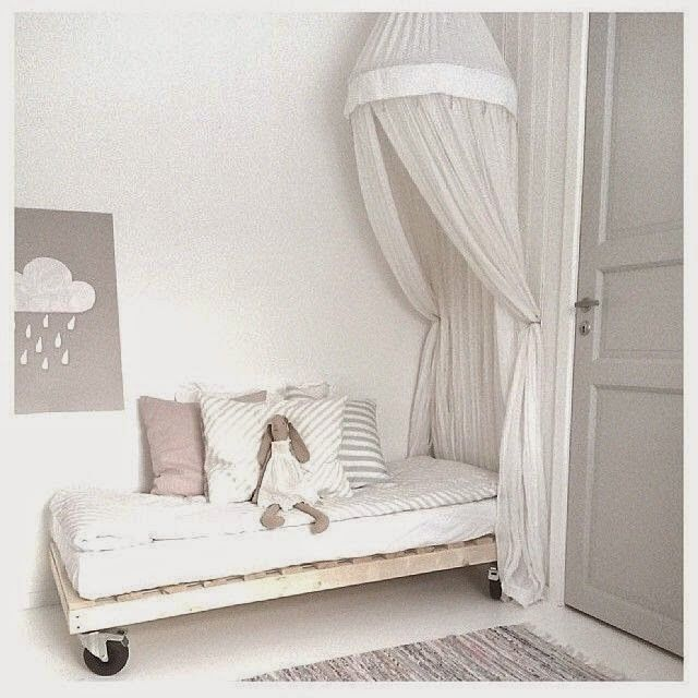 Gorgeous room and I love the bed on wheels!
