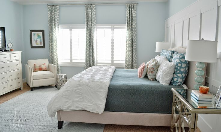 love the use of white wash furniture in the room. definitely brightens it up.  light blue, yellow, gray, white