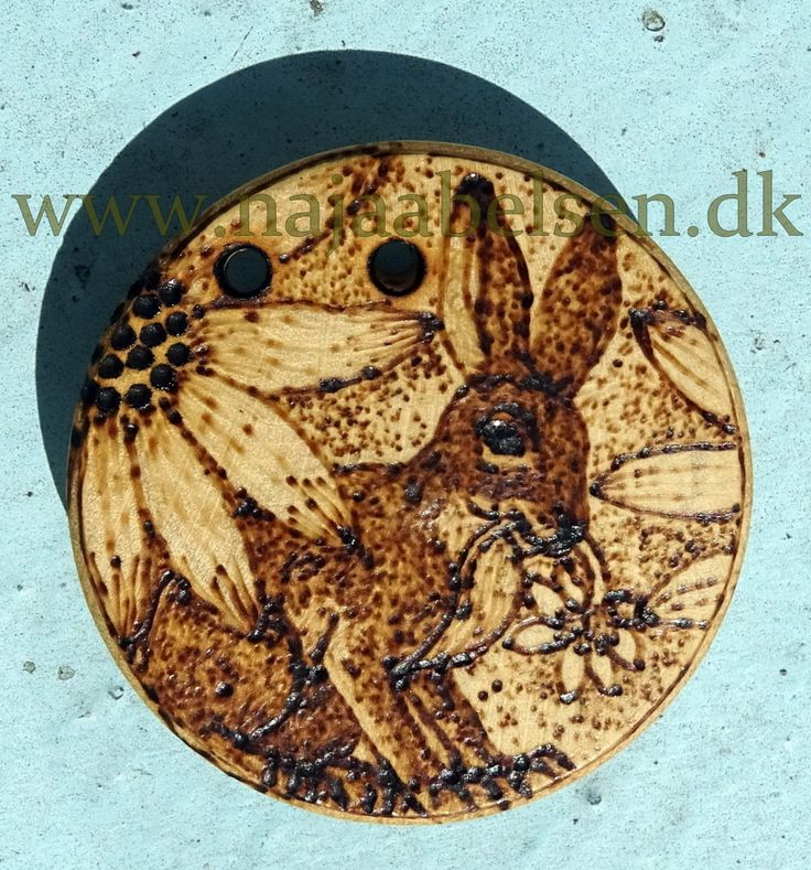 Rabbit-flower-pendant. Wood adorned with pyrography. 4 cm diameter. (2 holes for leatherstring) By wwwnajaabelsen.dk