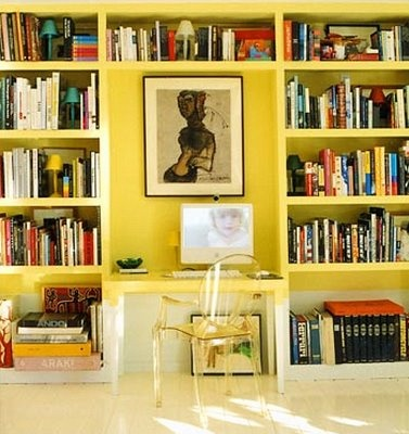 Bookshelves with a small desk in the middle for the entertainment room. Not loving the yellow, but this is pretty much perfect layout.