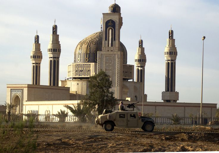 """Umm al-Qura Mosque, Baghdad, commemorating Saddam's victory in the 1991 Gulf war. """"It has four minarets on its perimeter, each resembling a Kalashnikov rifle barrel. Around the dome are another four minarets, each in the shape of a Scud missile on its launchpad."""""""
