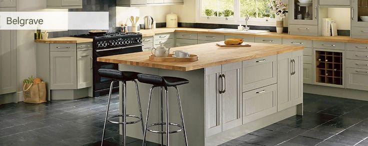 lovely green kitchen, butchers block worktops and black tiled floor
