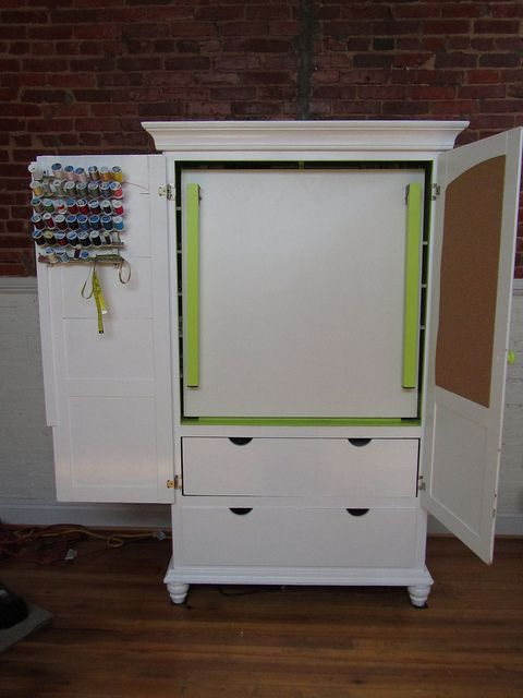 DIY craft armoire w/fold out table. you can still use the selves behind it for more storage ...Garden/potting center, kids craft center, ohh the possibilities.